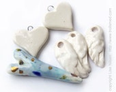 RESERVED S big porcelain heart, and one wing from image