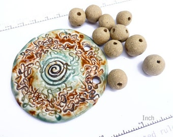 Set of huge pendant and crank-clay beads