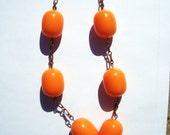 Circus peanut vintage orange lucite beads antique copper chain necklace