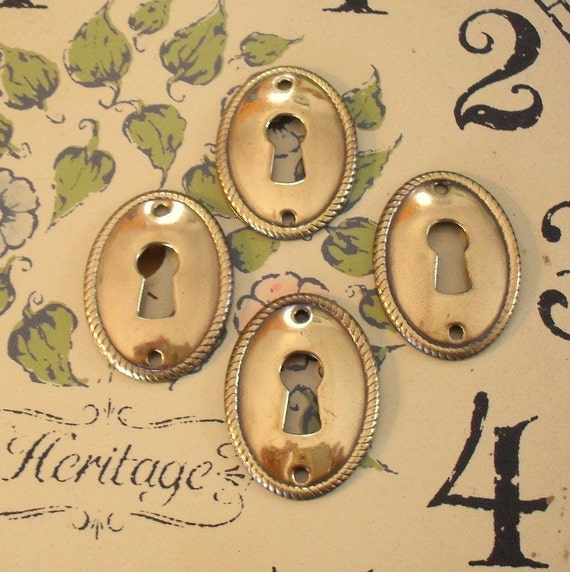 60 Brassy Skeleton Keyhole Covers reserved for Linda