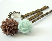 Mint chocolate chip bobby pin trio - mint green rose cabochon, brown mum cabochon, and clear acrylic gem on antiqued brass bobby pins