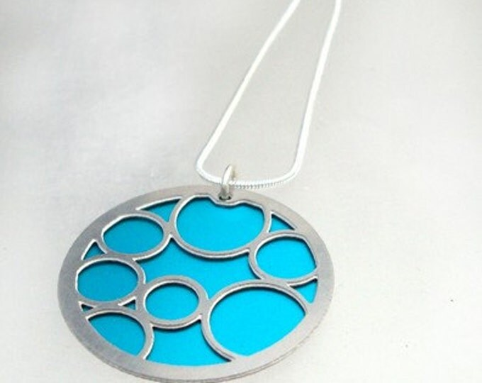 Round Pendant with Large Aqua Bubbles on the front and Black on the back