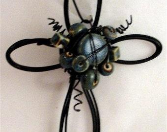 blue ceramic--  wire cross ornament