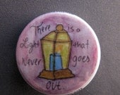 There is a light watercolor pinback button