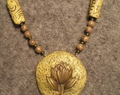 brass lotus necklace with earrings