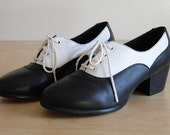 Black and White Leather Oxford Saddle Pumps