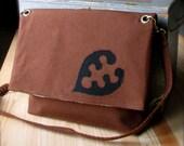 fold over messenger bag, vintage rust orange suiting with black leaf