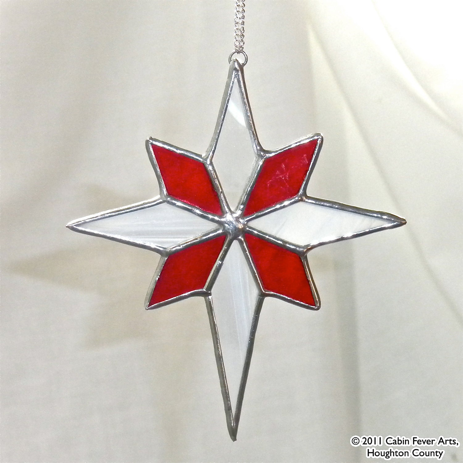 Red star in stained glass christmas tree ornament gift