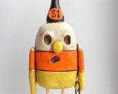 Candy Corn Man Yellow White and Orange clay folk art sculpture Halloween Decoration