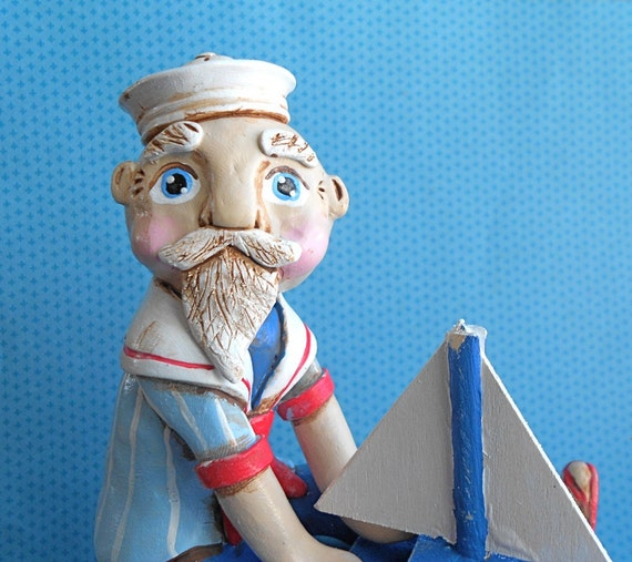 Santa on his Blue Sailboat clay folk art sculpture One of a Kind READY TO SHIP
