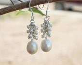 White pearl and sterling silver earrings.