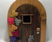 Wooden fairy doors by fairyrade