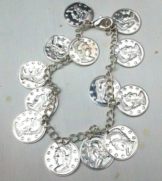 Charm bracelet with silver Roman faux coins