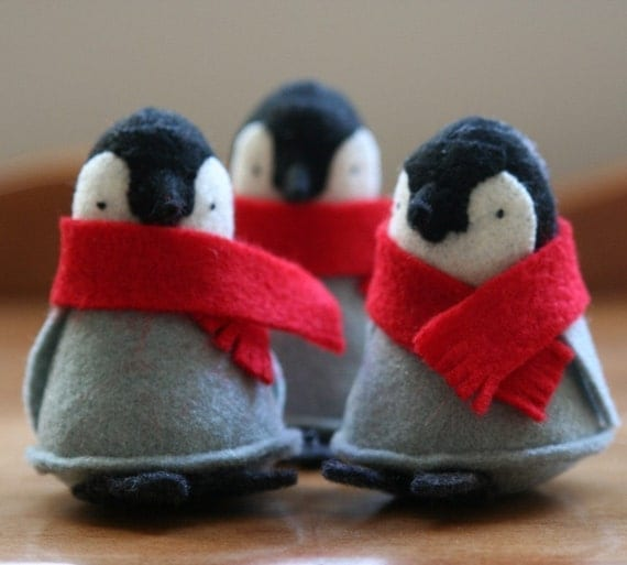 one penguin with red scarf