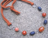 Eco-Friendly T Shirt Yarn Necklace - Sunrise, Sunset - Dark Orange T Shirt Yarn and Recycled Vintage Beads in Deep Blue and Pumpkin