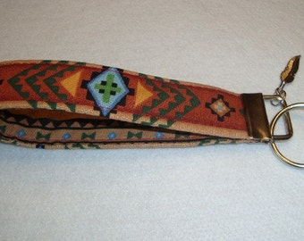Beautiful Southwest design key fob with feather charm