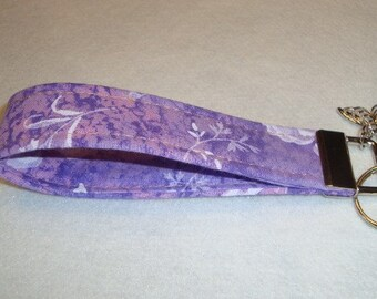 Beautiful wristlet fob in lavendar with pretty butterfly charm