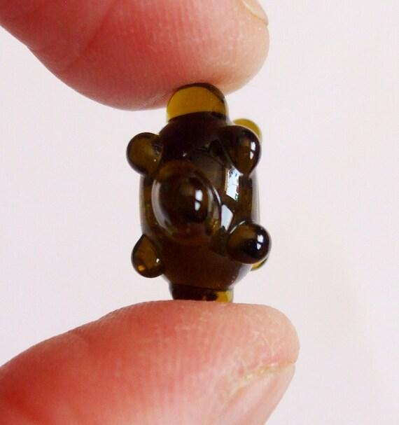 Quark . . Tiny Handmade Bead from Recycled Wine Bottle Glass