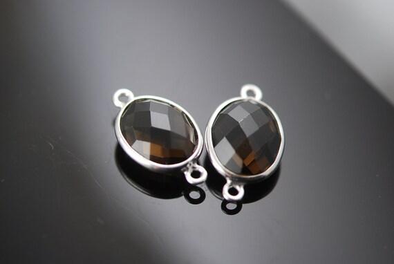 2 smokey quartz oval connectors 20.00 ON SALE 18.00  last set