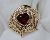 14 K Gold Blood Red Heart shaped Ruby and diamond ring