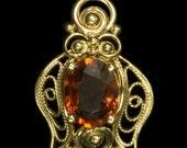 14K yellow gold Spessartite Garnet pendant. handmade