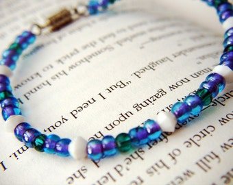 Purple, Teal and white beaded bracelet