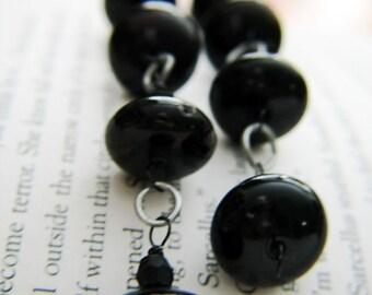 Dark droplets dangling earrings