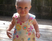Reversible Flower Dress lined with Rainbow Stripes...Criss-Cross back 12 months-6 years