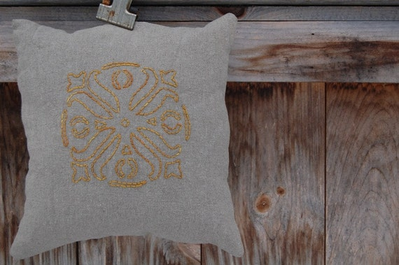 Gold leaf stencil embroidered pillow