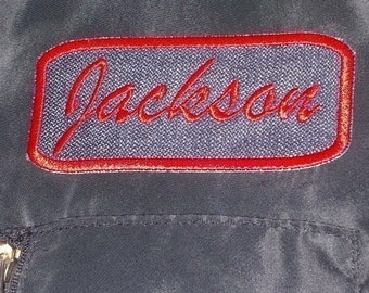 Denim Name Patch rectangle with red embroidery stitching.