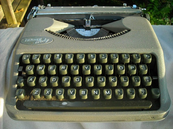 Hermes Baby Early 50s Portable Typewriter Super Sweet missing handle but Works GREAT Dark Green Keys Grey Case
