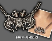 Elizabeth McGrath Siamise Bat Necklace