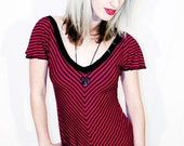 Riot Stripe magenta and black V stripe butterfly sleeve bow button top