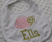 ONE Personalized Bib featuring an appliqued SWeeT SNaiL embroidered in pink and green