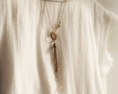 Delicate antiqued brass assymetrical chain fringe necklace with a sparrow bird, pastel glass beads - Dream