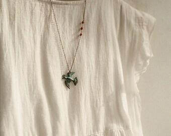 Magical bird - verdigris patina and coral beads asymmetrical necklace