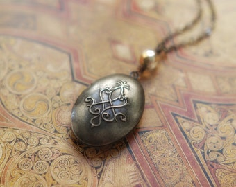 Silver plated locket necklace with mysterious embossed pattern and vintage crystal bead - the locket of Isis