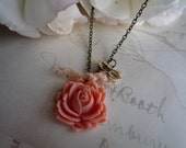 Opera necklace.. coral rosebud with lovely masquerade charm