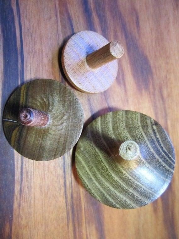Three handmade wooden toy spinning tops F