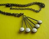 Atomic Star Burst Necklace in Creamy White