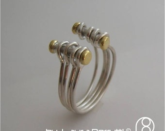 Sterling Silver and 14K gold Ring made of multiple rings