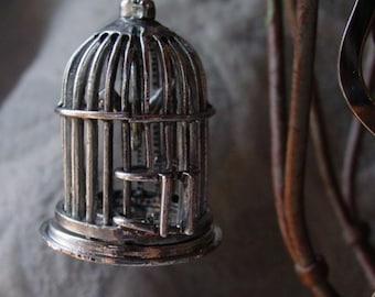 Squiggle bookmark bird cage trinket and sardonyx