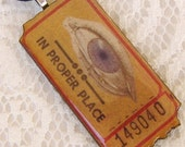 Circus Ticket, Keep an Eye Out, a wooden charm pendant