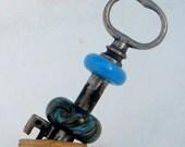 Vintage skeleton key with lampwork beads