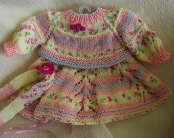 Unique knit baby dress and headband .