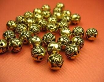 16 Lucite Carved Gold Rosebud Beads
