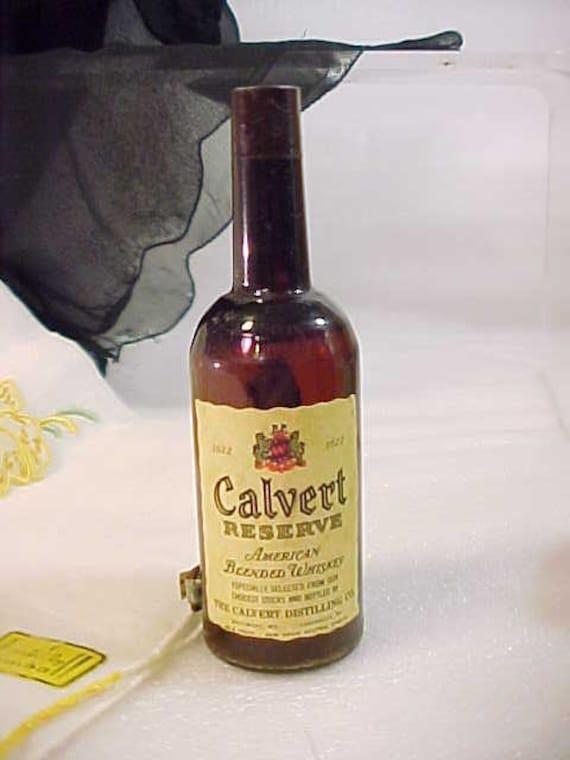 Vintage Japan Celluloid Measuring Tape Calvert Whiskey Bottle