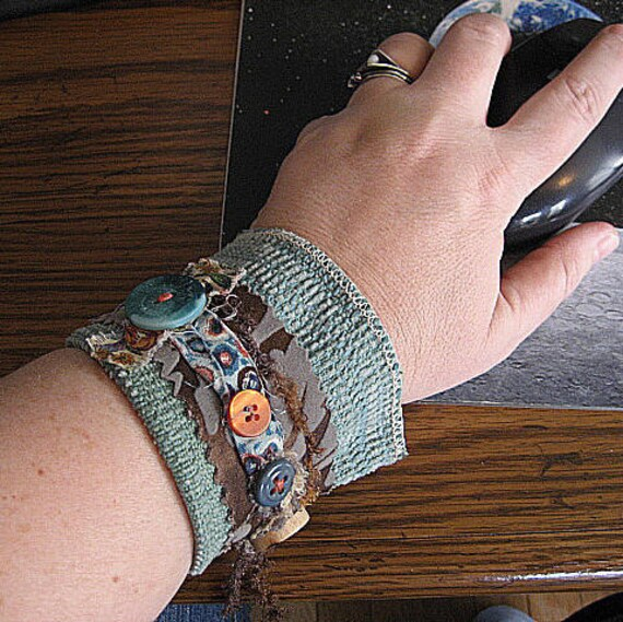 fabric wrist cuff coffee cozy sleeve with vintage buttons