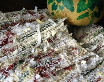 Place mats made from knitted strips of fabric, set of two