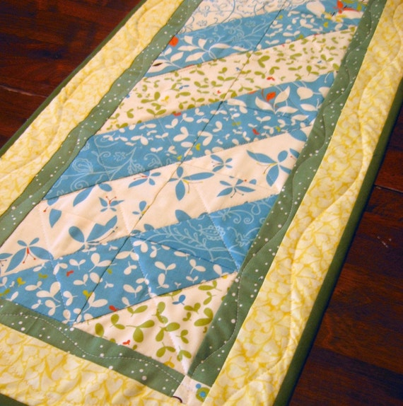 Quilted table runner featuring Moda fabrics from Country By Design